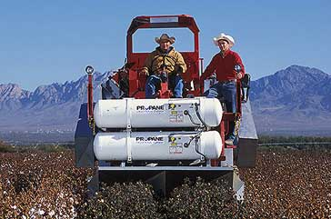Operation of an experimental thermal defoliator for cotton. (USDA-ARS photo by Peggy Greb)